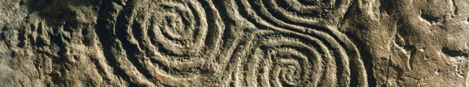 Tri-spiral carving at Newgrange (abstract detailed photo)